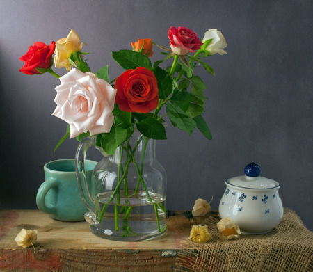 physalis: Still life with colorful roses and physalis Stock Photo