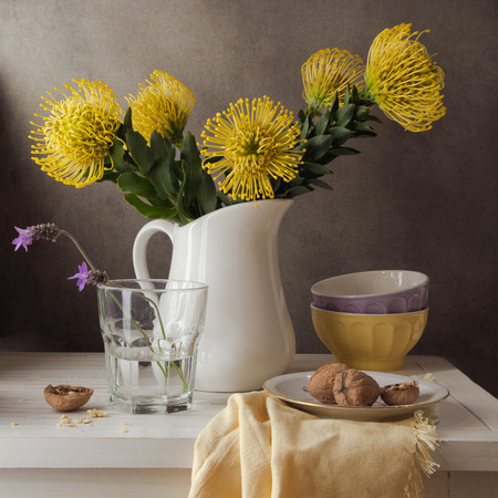 still water: Still life with bouquet of yellow flowers