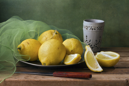 Still life with lemons and green gauze photo