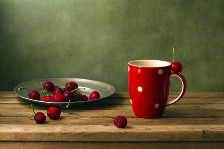 arrangment: Still life with cherries and red cup