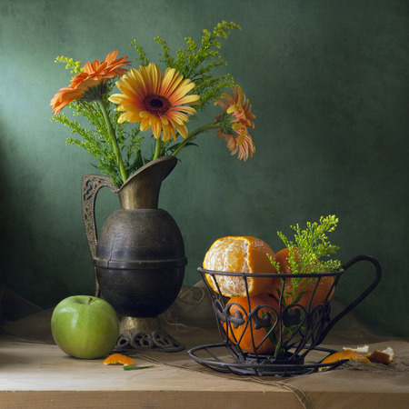 Still life with orange gerbera daisy flowers and tangerines Stok Fotoğraf