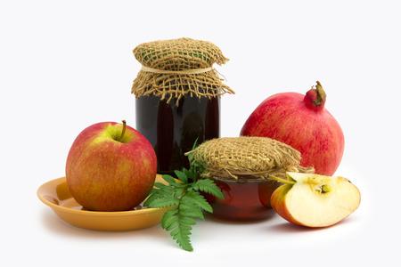 honey apple: Jar of honey, apple and pomegranate on white background