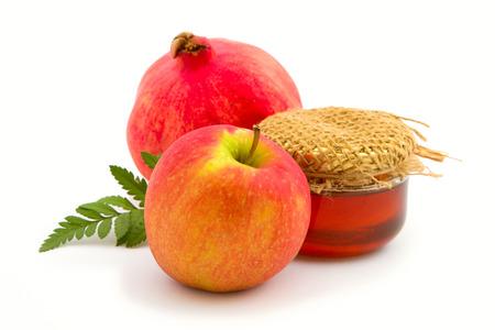 apple and honey: Apple, honey and pomegranate on white background.