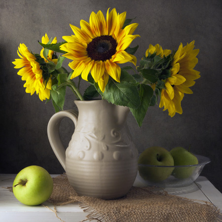 Classical still life with beautiful sunflowers bouquet