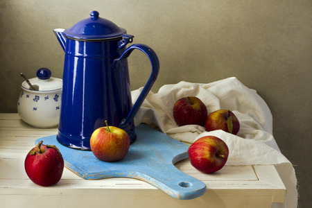 Still life with enamel vintage jug and fresh apples