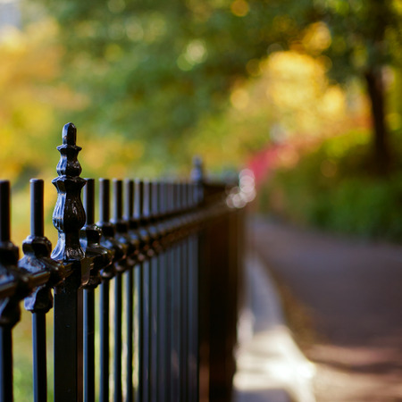 metal fence: Fence against beautiful bokeh background Stock Photo