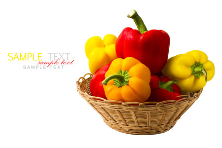 preperation: Fresh peppers in basket isolated on white background