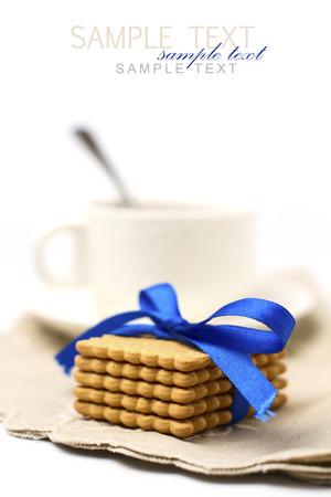 ribbin: Biscuits cookies tied with blue ribbon on white background