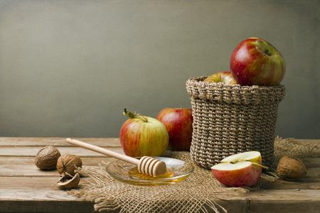 honey tone: Still life with apples, walnuts and honey. Stock Photo