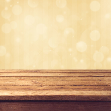 Golden bokeh background with wooden table Stockfoto