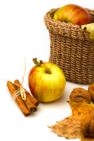 Still life with apples and autumn leaves on white background Stock Photo