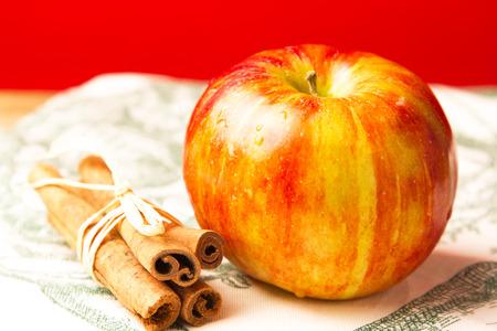 Fresh apple and cinnamon stick