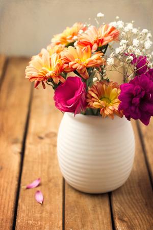 Beautiful flower bouquet on wooden tabletop