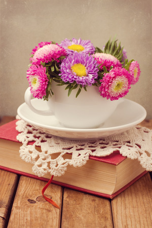 Vintage romantic still life with flowers and book photo