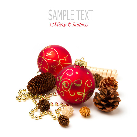 Christmas baubles and pine corn on white background