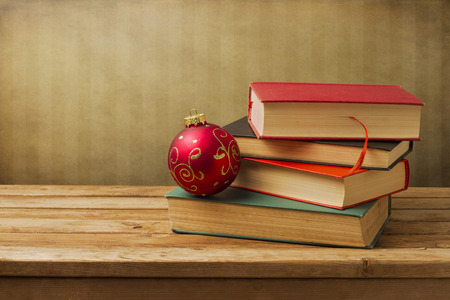 Books with christmas ornament on wooden table Stock Photo