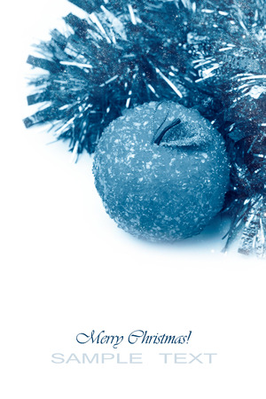 Winter toned christmas image with decorations over white background