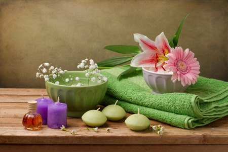 Spa concept still life with candles, towels and flowers photo