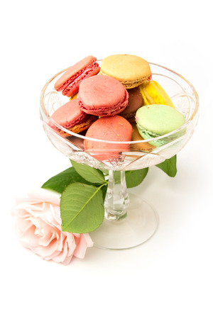 Colorful macaroons and rose on white background Stock Photo
