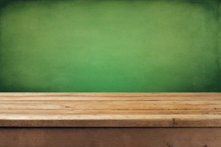 tabletop: Wooden deck tabletop with grunge green wall Stock Photo