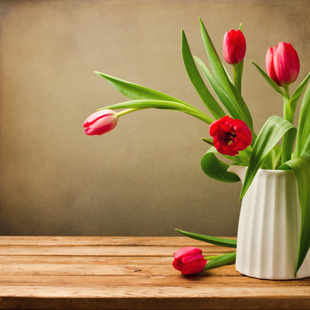Beautiful tulips bouquet on wooden table. Valentines Day background