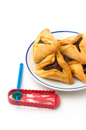 hamantaschen: Hamantaschen cookies and grogger forJewish festival of Purim