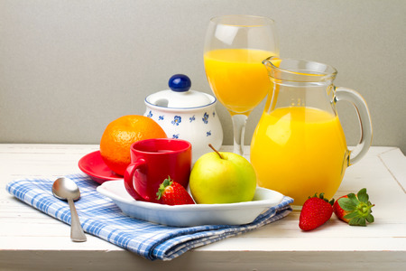 Breakfast with fresh fruits on white table photo