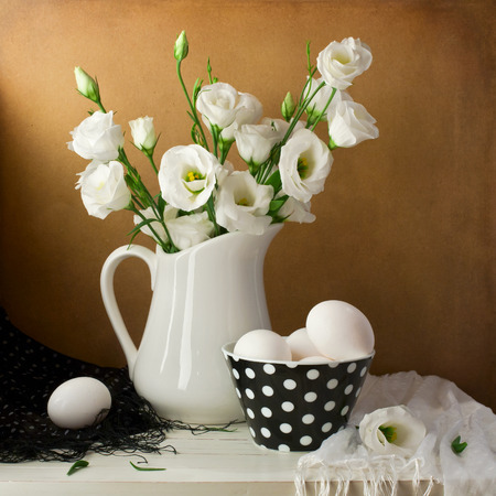 Spring still life with white flowers and eggs Stock Photo