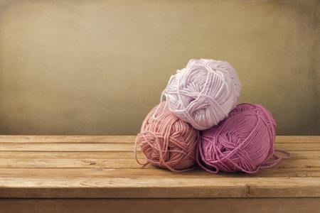 craft materials: Knitting threads on wooden table. Craft materials. Stock Photo