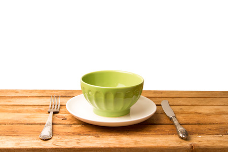 Wooden table arrangement on white background