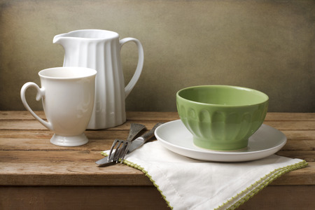 Still life with white and green tableware arrangement
