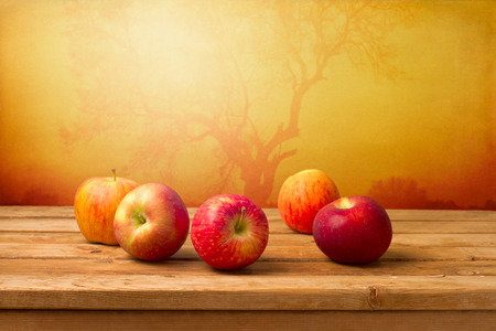 Fresh red apples over autumn background Stock Photo