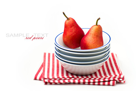 Red pears in bowls over white background