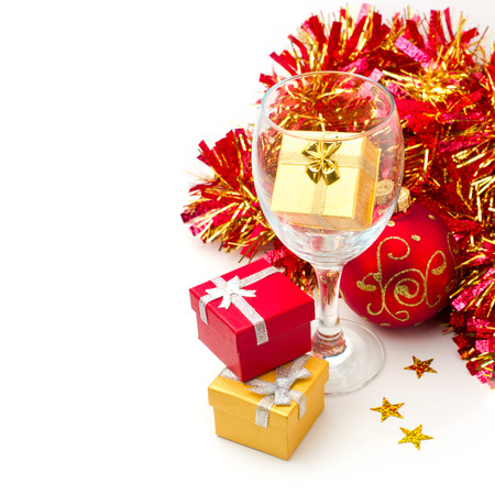 Christmas holiday still life with gift boxes and wine glass over white background