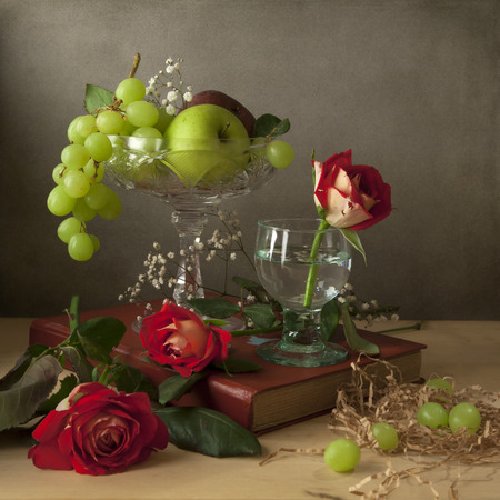 Still life with fruits and roses Stock Photo