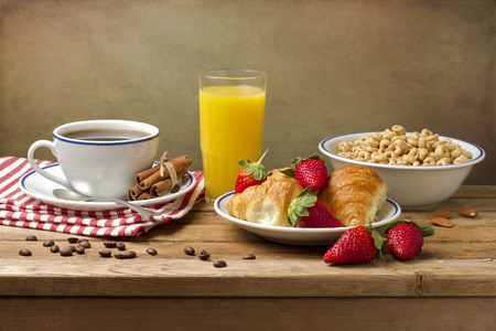 Breakfast setting on wooden table photo