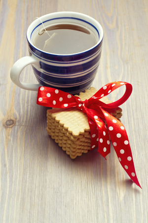 tabletop: Warm cup of tea with cookies on wooden tabletop