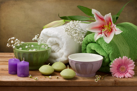 Spa concept still life with candles and towels photo