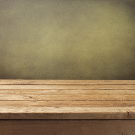 surface: Retro background with wooden table and grunge wall