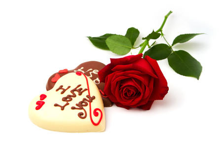 i love you heart: Valentines Day concept. Heart shape chocolate and red rose on white background