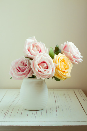 roses in vase: Beautiful rose bouquet on white table