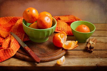 Still life with orange mandarins on wooden table Stock Photo