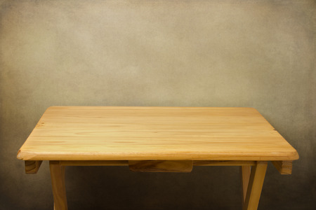 table surface: Wooden table over grunge background