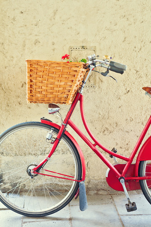 bicycle: Vintage bicycle with basket over concrete wall