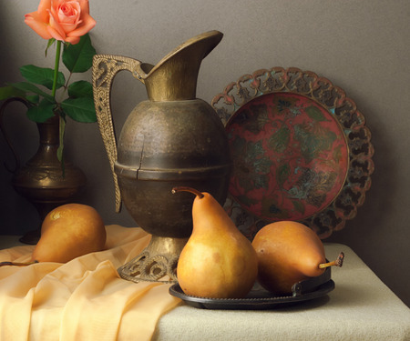 Vintage still life with brown pears