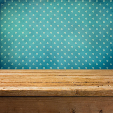 table: Background with wooden deck table and vintage polka dots wallpaper