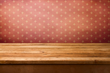 Vintage retro background with wooden deck table and wallpaper with ornament