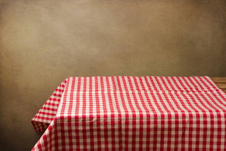 red kitchen: Background with table and tablecloth over grunge background