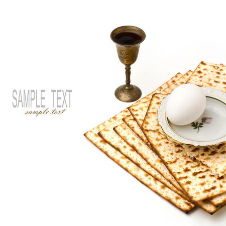 matzoth: Matzo, egg and wine for passover celebration on white background