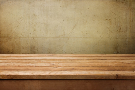 table: Empty wooden table over grunge concrete wall for product montage